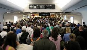 Holiday Travelers At A Crowded Airport
