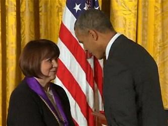 President Barack Obama presents the National Medal of Arts to US singer Linda Ronstadt