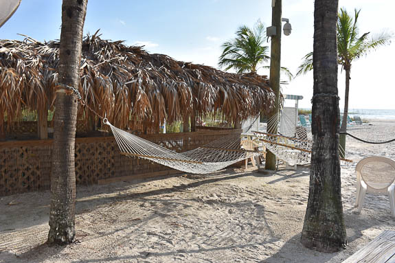 Relax in a hammock by the beach at Cedar Cove Resort & Cottages on Anna Maria Island, FL