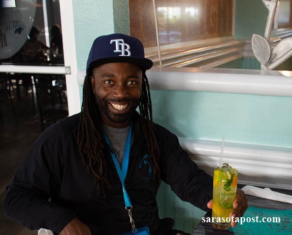 Customer at Tarpon Bay Grill & Tiki enjoys a drink while listening to music at the inside venue.