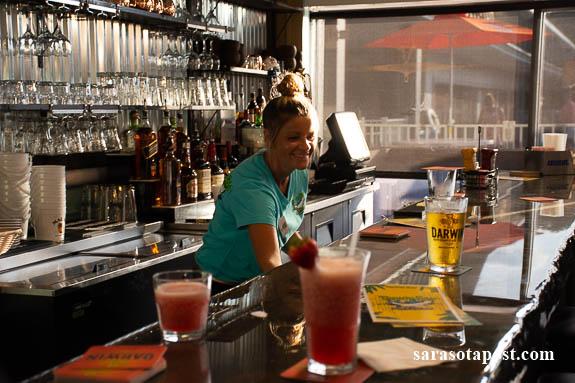 The bartender at Tarpon Bay Grill & Tiki taking care of customers.