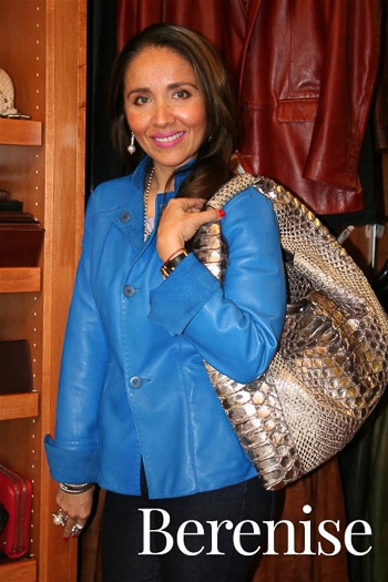 Berenise, owner of Eleganza Leather in Sarasota, FL, models one of the unique bags for sale.