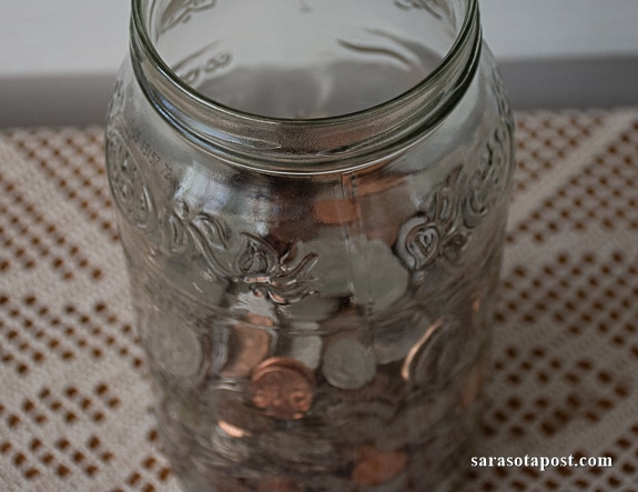 A good old-fashioned jar to save your change can help.