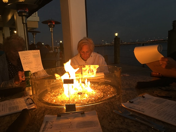 The Riverhouse Reef & Grill in Palmetto, FL has fire-pit tables to sit at on cool evenings.
