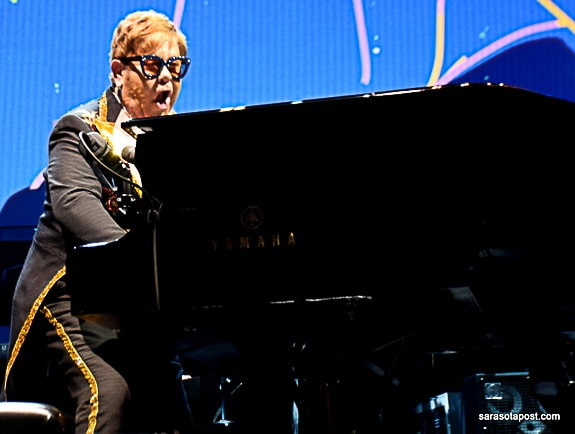 Elton John at his piano on his Farewell Yellowbrick Road Tour at Amalie Arena in Tampa, FL