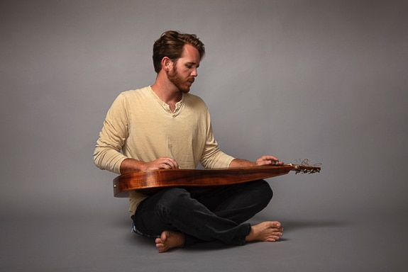 Trevor Bystrom plays many instruments, including the Weissenborn slide guitar in Southwest Florida.