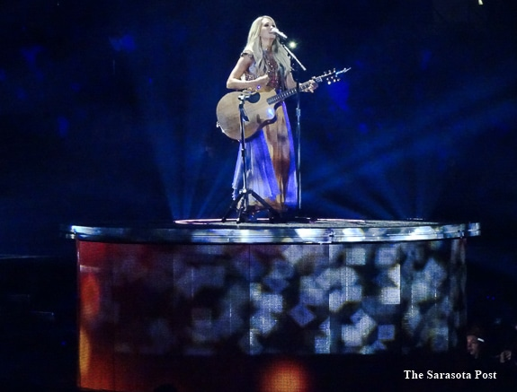 Carrie Underwood performs with her guitar in L.A. California