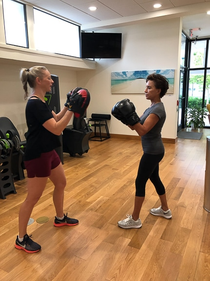 Debbie Rock of Rock PT Fitness leads a client in a boxing exercise in Sarasota, FL