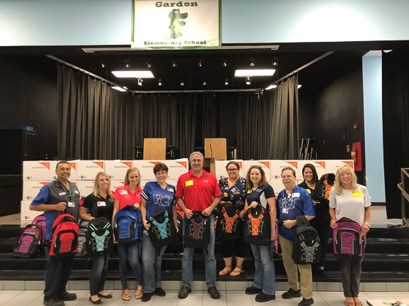 PGT Innovations' team members who helped assemble backpacks