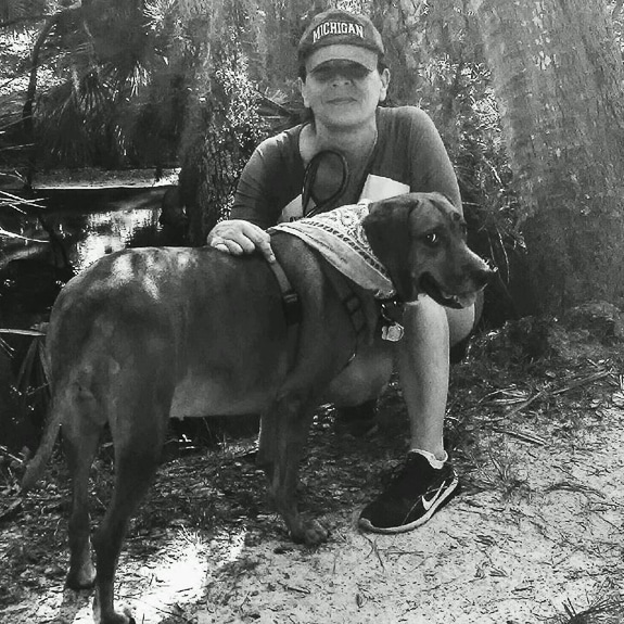 The author, Jodi, with her dog.