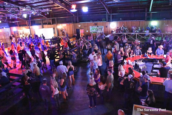 Dancers on the dance floor and people all over enjoying country music at Joyland in Bradenton, FL