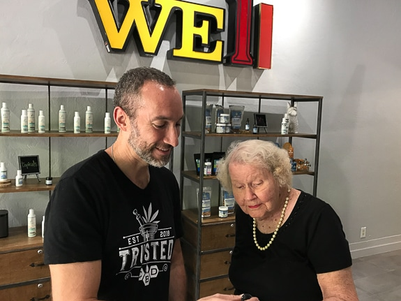 Daniel Plonsky, owner of TrustedCBD, helps one of his customers.