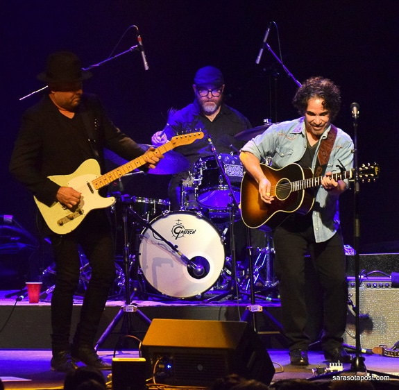 Guthie Trapp (guitar), Josh Day (drums), and John Oates