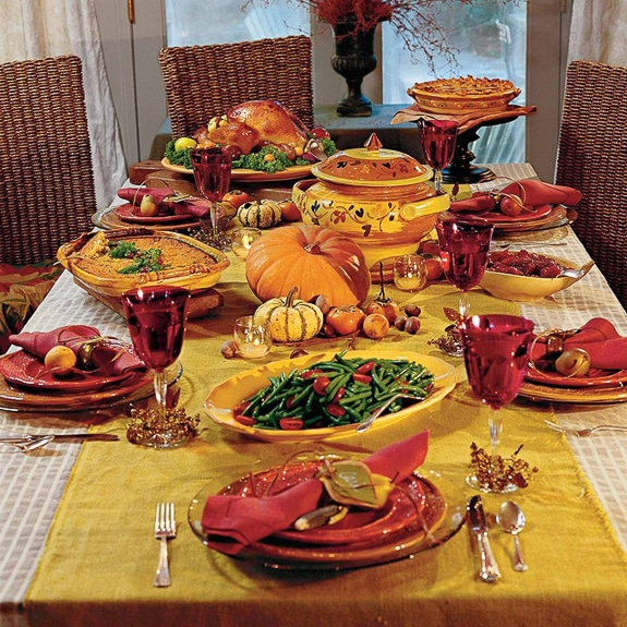 A feast laid out on a beautiful Thanksgiving table.