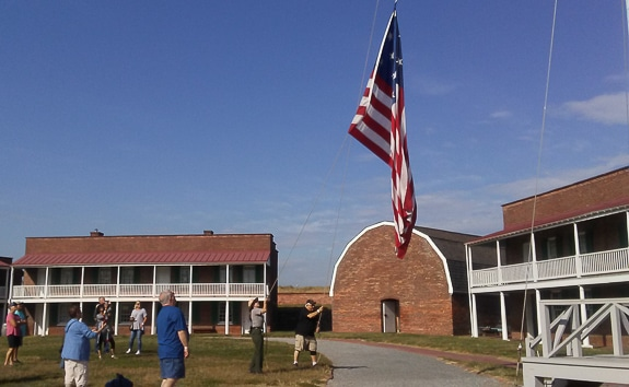 Inside Fort McHenry with barracks and the round top Armory and Flag raising ceremony of large 15 star flag