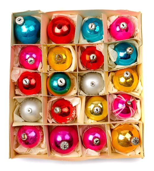 A box of glass Christmas ornaments.