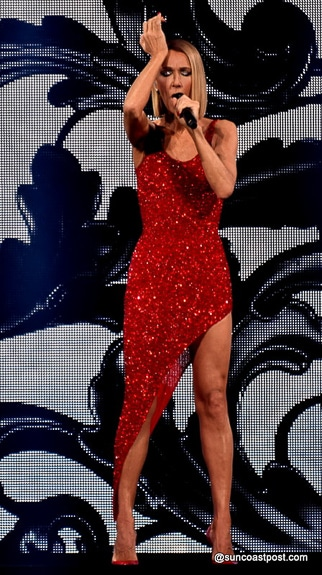 Celine Dion wore a red sequined high=thigh slit gown/