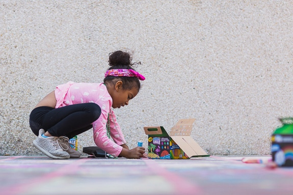 Little girl making chalk art from Artslam 2018 in Bradenton, FL