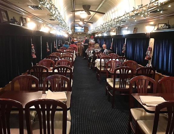 The interior to the initial dining car is simple but elegant.