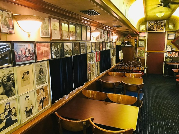 There's additional seating and posters in the final car, which is anchored by a 1910 upright piano - which also is being restored.