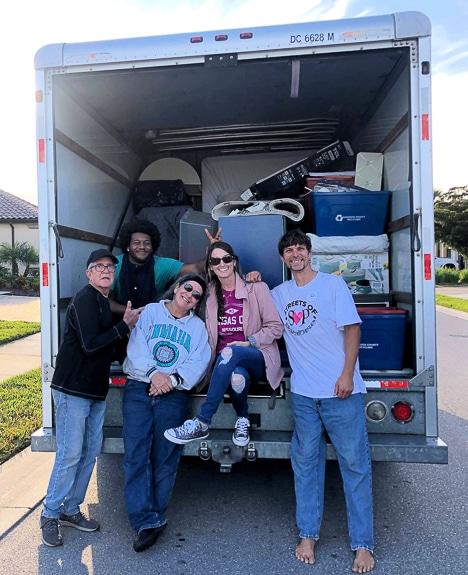 Volunteers help move furniture and things in Sarasota