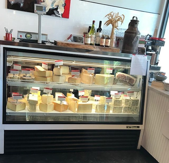 So many cheeses to choose from at Artisan Cheese Company in Sarasota, FL
