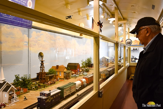 Stanley Kotas with detailed miniature train village at the Florida Train Museum