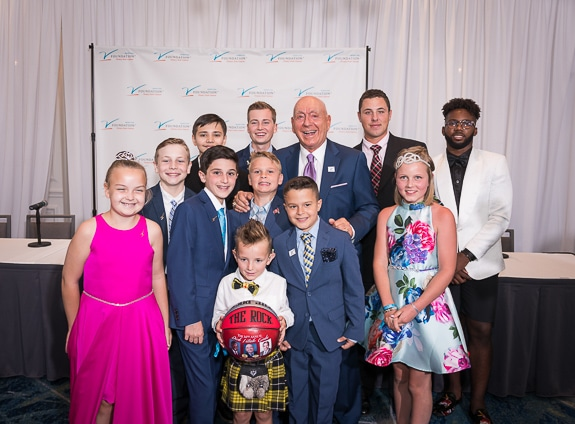 Dick Vitale and his All Courageous Team from 2019