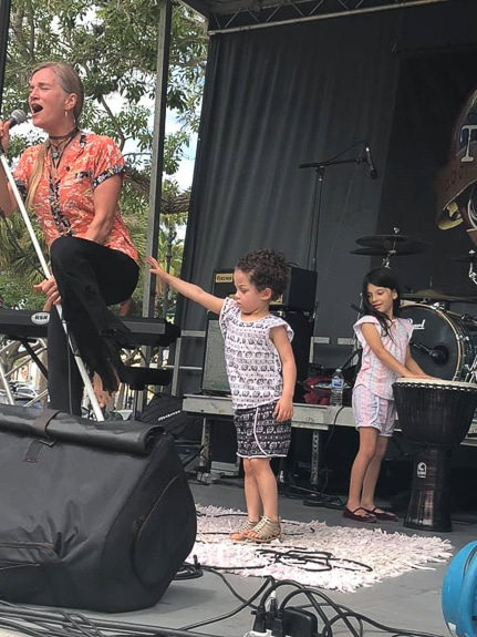Twinkle performing with her 2 grand-daughters.