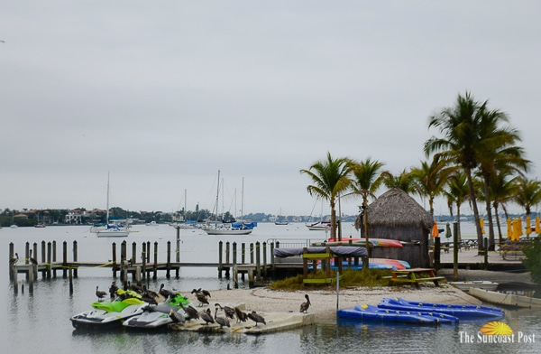 Bayfront with tiki and boats