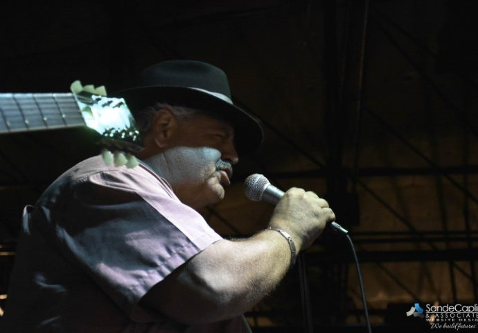 Tim Calandra singing into microphone
