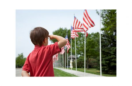 Memorial Day boy saluting flags